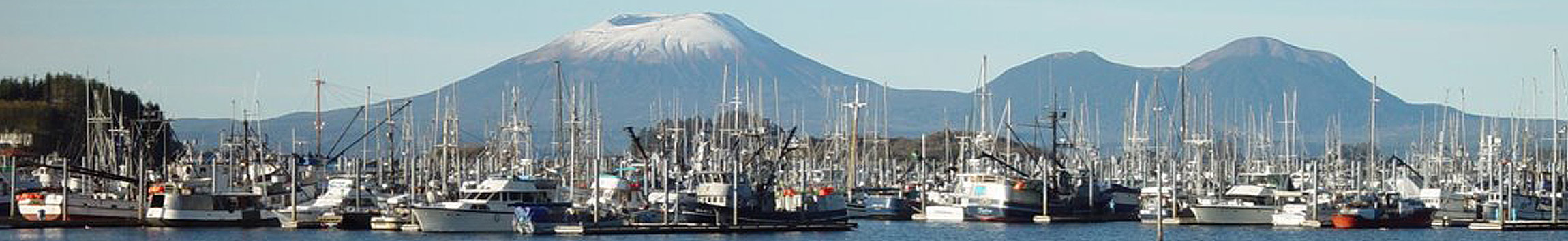 Mount Edgecumbe stands over a harbor in Sitka, Alaska